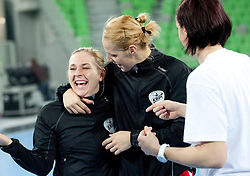 Kristina Bille and Gorica Acimovic of Krim celebrate after the handball match between RK Krim Mercator and Larvik HK (NOR) of Women's EHF Champions League 2011/2012, on November 13, 2011 in Arena Stozice, Ljubljana, Slovenia. Larvik defeated Krim 22-19 but both teams qualified to new round. (Photo By Vid Ponikvar / Sportida.com)