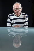 senior person looking at self reflection