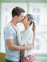Passionate couple kissing in house