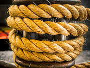 "10 AUGUST 2013 - HONG KONG:  Coiled rope on a Star Ferry ship in Hong Kong. The Star Ferry, or The ""Star"" Ferry Company, is a passenger ferry service operator and tourist attraction in Hong Kong. Its principal routes carry passengers across Victoria Harbour, between Hong Kong Island and Kowloon. It was founded in 1888 as the Kowloon Ferry Company, adopting its present name in 1898.<br /> The fleet of twelve ferries currently operates two routes (four prior to April 1, 2011) across the harbour, carrying over 70,000 passengers a day, or 26 million a year. Even though the harbour is crossed by railway and road tunnels, the Star Ferry continues to provide an inexpensive mode of harbour crossing. The company's main route runs between Central and Tsim Sha Tsui. Hong Kong is one of the two Special Administrative Regions of the People's Republic of China, Macau is the other. It is situated on China's south coast and, enclosed by the Pearl River Delta and South China Sea, it is known for its skyline and deep natural harbour. Hong Kong is one of the most densely populated areas in the world, the  population is 93.6% ethnic Chinese and 6.4% from other groups. The Han Chinese majority originate mainly from the cities of Guangzhou and Taishan in the neighbouring Guangdong province.      PHOTO BY JACK KURTZ"