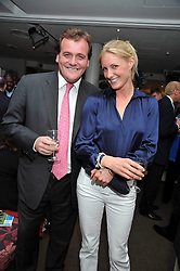 Horse racing figure RICHARD HANNON and his girlfriend JEMIMA at the launch of the 2009 Derby Festival in the presence of HRH Princess Haya of Jordan in aid of the charity Starlight held at the Kensington Roof Gardens, 99 Kensington High Street, London W8 on 12th May 2009.