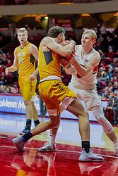 NORMAL, IL - February 05: Markus Golder and Isaac Gassman both attempt to gain possession during a college basketball game between the ISU Redbirds and the Valparaiso Crusaders on February 05 2019 at Redbird Arena in Normal, IL. (Photo by Alan Look)