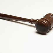 Courtroom gavel symbol of US Justice System. Also judge's gavel and order in the court.