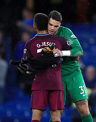 Manchester City goalkeeper Ederson greets teammate Gabriel Jesus after the final whistle during the Premier League match at Stamford Bridge, London.
