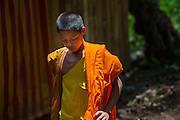 Buddhist boy monk in orange robe (Laos)