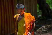 Buddhist boy monk in orange robe (Laos)