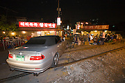 Hongdae. Famous open-air grilled meat restaurants on a railway crossing which isn't active at nighttime.