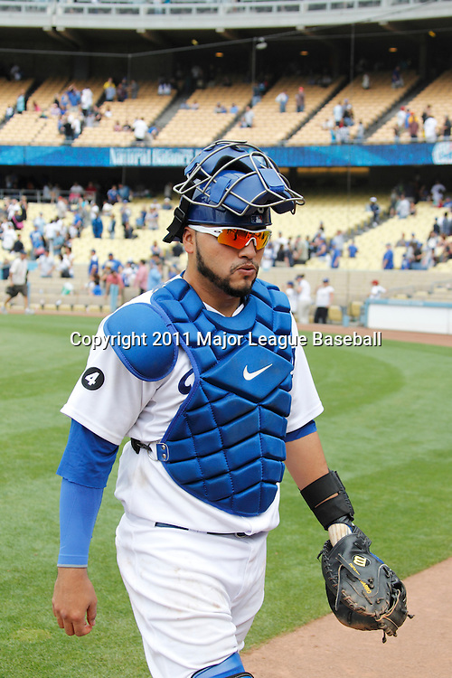 LOS ANGELES - JUNE 19:  Catcher Dioner Navarro #30 of the Los Angeles Dodgers walks back to the dugout during the game against the Houston Astros at Dodger Stadium on Sunday, June 19, 2011 in Los Angeles, California.  The Dodgers defeated the Astros 1-0.  (Photo by Paul Spinelli/MLB Photos via Getty Images) *** Local Caption *** Dioner Navarro