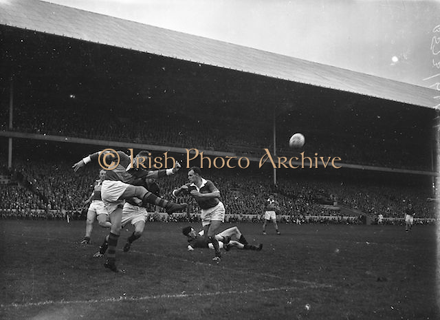 Kerry goalie J Cullotty kicks the ball clear during the All Ireland Senior Gaelic Football Final Kerry v Down in Croke Park on the 22nd September 1960. Down 2-10 Kerry 0-8.