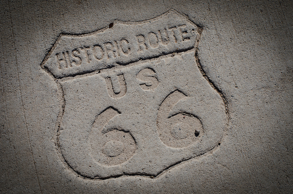 Historic US Route 66 stamped into the pavement on a sidewalk at one of the prominent intersections along the Mother Road. Tucumcari, New Mexico.