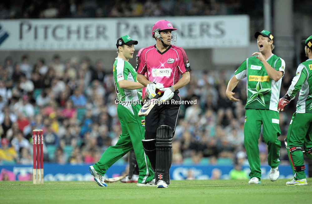 27.12.2011 Sydney, Australia.The Stars celebrate as Sydney Sixers all rounder Moisés Henriques  is dismissed during the KFC T20 Big Bash League game between the Sydney Sixers  and the Melbourne Stars at the Sydney Cricket Ground.