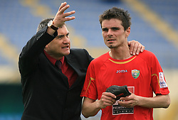 Coach of Rudar Marijan Pusnik talking to Alem Mujakovic at 26th Round of Slovenian First League football match between NK Domzale and NK Rudar Velenje in Sports park Domzale, on April 4, 2009, in Domzale, Slovenia. (Photo by Vid Ponikvar / Sportida)