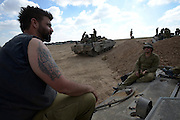 UNSPECIFIED, ISRAEL - JULY 19, 2014: Israeli reserve soldiers in an army deployment area near Israel's border with the Gaza Strip, on July 19, 2014,  on the second day of Israeli ground invasion into Gaza Strip in order to destroy terror tunnels infrastructure. Photo by Gili Yaari