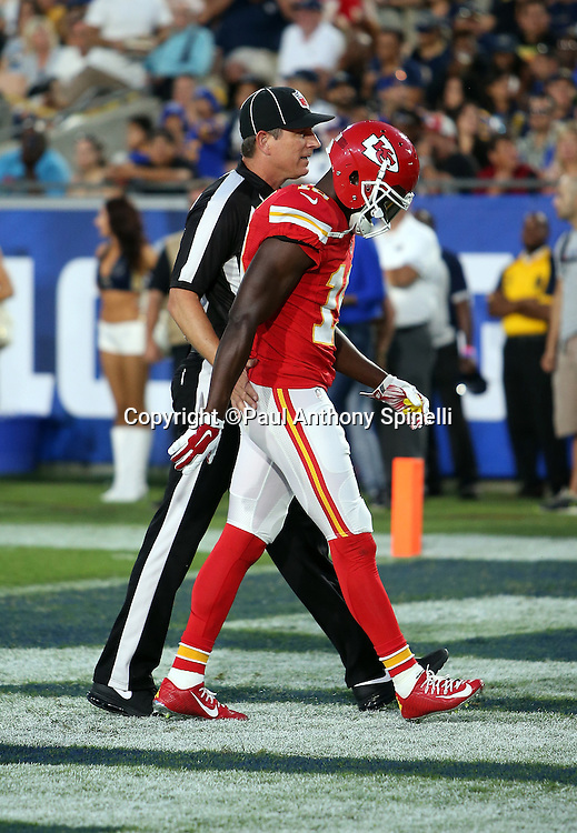 An NFL official walks Kansas City Chiefs wide receiver Jeremy Maclin (19) off the field with his head held low due while being ejected for fighting with Los Angeles Rams cornerback Lamarcus Joyner (20), both players were ejected from the game, during the 2016 NFL preseason football game against the Los Angeles Rams on Saturday, Aug. 20, 2016 in Los Angeles. The Rams won the game 21-20. (©Paul Anthony Spinelli)
