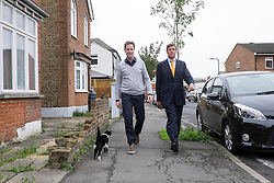 © Licensed to London News Pictures. 26/04/2015. Sutton, UK.  NICK CLEGG, PAUL BURSTOW on Orchard Road.  leaflets Orchard Road in Sutton.  Deputy Prime Minister and Leader of the Liberal Democrats Nick Clegg makes a speech today, 26th April 215 in Sutton, to local Liberal Democrats in support of the candidate for Sutton and Cheam, Paul Burstow. Nick Clegg and Paul Burstow also joined local campaigners to deliver leaflets on a nearby street, and put up a Liberal Democrat stakeboard.. Photo credit : Stephen Simpson/LNP