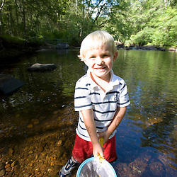 A young boy (age 3) plays in the Eightmile River in Lyme, Connecticut.  The Nature Conservancy's Pleasant Valley Preserve.  Connecticut River tributary.