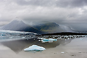 Fjallsarlon is a glacier lake near Vatnajokull. Like Jokulsarlo nearby, it also has some floating icebergs.