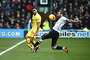 MK Dons defender George Baldock and Derby County midfielder Bradley Johnson during the Sky Bet Championship match between Derby County and Milton Keynes Dons at the iPro Stadium, Derby, England on 13 February 2016. Photo by Jon Hobley.