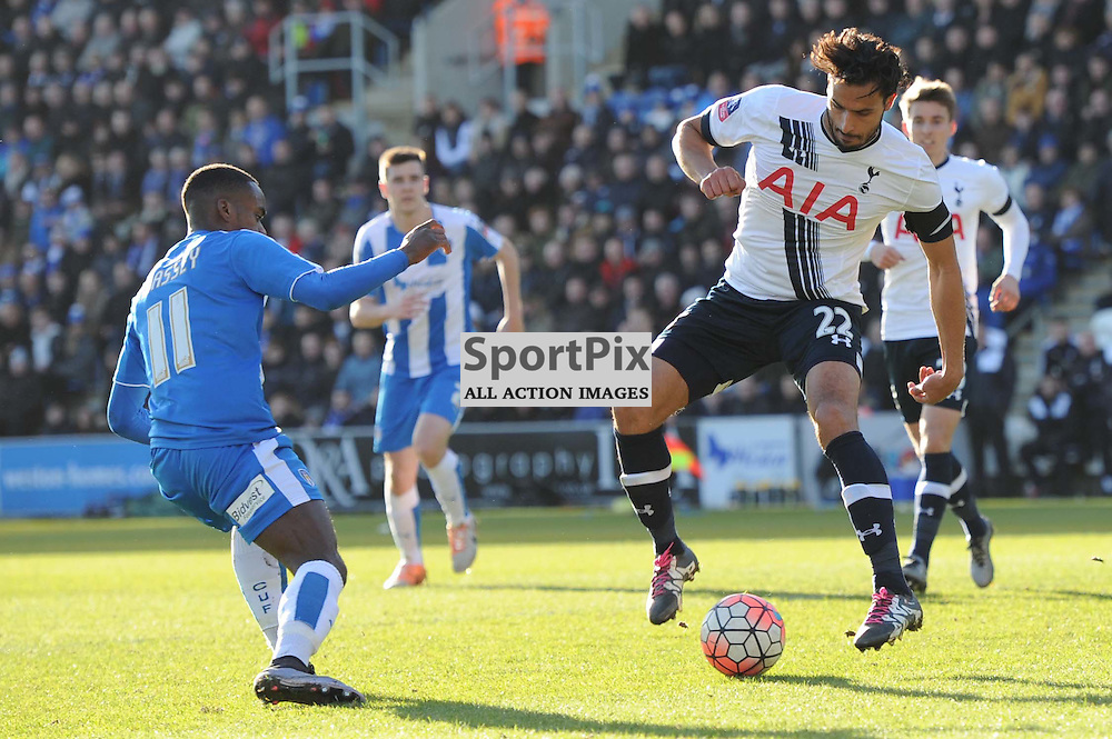 Colchesters Gavin Massey and Tottenhams Nacer Chadli in action during the Colchester v Tottenham game in the FA Cup 4th Round on the 30th January 2016.
