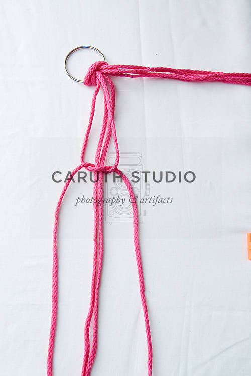 Step three to make a square knot with macrame cord