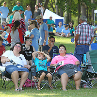 Local residents start to file into Ballard Park to attend the Picnic in the Park Fourth of July Celebration Wednesday afternoon in Tupelo.