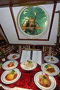 Dinner aboard Star Clipper. Dive Master Bonnie has a look at tonight's sample dishes.