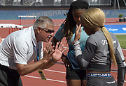 LSU Tigers coach Dennis Shaver  (left) talks with Aleia  Hobbs  (center)  and Sha'Carri Richardson at a training session  prior to the 45th Prefontaine Classic, Saturday, June 29, 2019, in Stanford,  Calif.