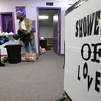 Tonya Moore and her husband, Charles, put fresh towels and other items in place as they offer free laundry services and shower facilites to area homeless in Tupelo.