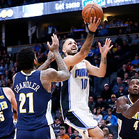 11 November 2017: Orlando Magic forward Evan Fournier (10) goes for the layup past Denver Nuggets center Nikola Jokic (15), Denver Nuggets forward Wilson Chandler (21) and Denver Nuggets forward Paul Millsap (4) during the Denver Nuggets 125-107 victory over the Orlando Magic, at the Pepsi Center, Denver, Colorado, USA.