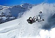 Tim Hoff goes sideways on a reentry on his Skidoo sled in the Tetons.