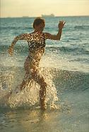 Running in water, Miani Beach, NY