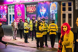 "© Licensed to London News Pictures . 15/12/2017. Manchester, UK. Several police officers respond to an incident at Club Tropicana in the city's Gay Village . Revellers out in Manchester City Centre overnight during "" Mad Friday "" , named for historically being one of the busiest nights of the year for the emergency services in the UK . Photo credit: Joel Goodman/LNP"