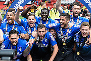 Bournemouth players celebrate after winning the Sky Bet Championship trophy after the Sky Bet Championship match between Charlton Athletic and Bournemouth at The Valley, London, England on 2 May 2015. Photo by David Charbit.