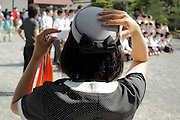 female tour guide holding her hat Japan