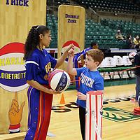 Libby Ezell | BUY AT PHOTOS.DJOURNAL.COM<br /> Gage Luther, who just turned 7 and who's birthday present was to come and meet the Harlem Globetrotters, learns to spin a ball on his finger from Ace