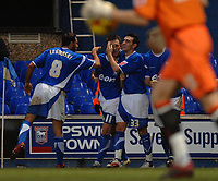 Photo: Ashley Pickering.<br />Ipswich Town v Leeds United. Coca Cola Championship. 16/12/2006.<br />Gavin Williams (no. 11) celebrates with team mates after opening the scoring for Ipswich