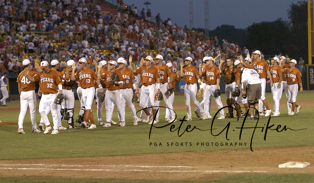 The Texas Longhorns celebrate after beating Florida 4-2 in the first game of the Championship Series of the College World Series at Rosenblatt Stadium in Omaha, Nebraska on June 25, 2005.