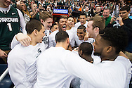 27 MAR 2015: The Michigan State University team huddles prior to their game against the University of Oklahoma during the 2015 NCAA Men's Basketball Tournament held at the Carrier Dome in Syracuse, NY. Michigan State defeated Oklahoma 62-58. Brett Wilhelm/NCAA Photos