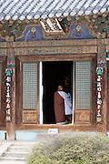 Songnisan National Park. Beopjusa Temple. Praying monk.