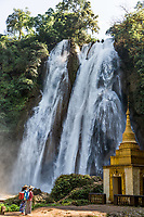 PYIN OO LWIN, MYANMAR - NOVEMBER 29, 2016 :  two young woman praying in front of Dat Taw Gyaint Waterfall Anisakan Pyin Oo Lwin Mandalay state Myanmar (Burma)
