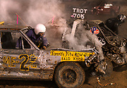 Arkansas Democrat-Gazette/BENJAMIN KRAIN --9/14/2013--<br /> A driver escapes through the windshield after his car ignites from being smashed during the White County Fair Demolition Derby