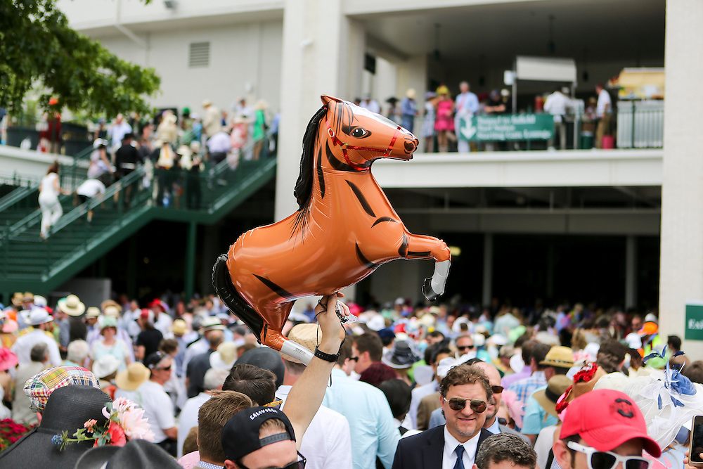 LOUISVILLE, KY - MAY 7:  A man holds up a balloon in the shape of a horse as he walks towards the infield prior to the 142nd running of the Kentucky Derby at Churchill Downs on May 7, 2016 in Louisville, Kentucky. (Photo by Michael Reaves/Getty Images)