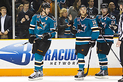January 11, 2011; San Jose, CA, USA; San Jose Sharks center Patrick Marleau (12) celebrates with center Joe Thornton (19) and right wing Devin Setoguchi (16) after scoring a goal against the Toronto Maple Leafs during the first period at HP Pavilion. Mandatory Credit: Jason O. Watson / US PRESSWIRE