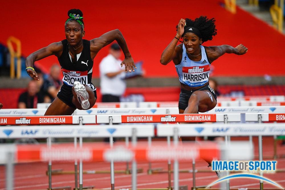 Kendra Harrison (USA), right, leads Janeek Brown (JAM) in the heats of the women's 100m hurdles during the Birmingham Grand Prix, Sunday, Aug 18, 2019, in Birmingham, United Kingdom. (Steve Flynn/Image of Sport)