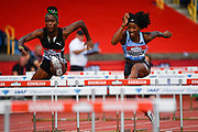 Kendra Harrison (USA), right, leads Janeek Brown (JAM) in the heats of the women's 100m hurdles during the Birmingham Grand Prix, Sunday, Aug 18, 2019, in Birmingham, United Kingdom. (Steve Flynn/Image of Sport)
