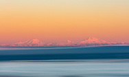 Alpenglow on Mount Foraker and Denali at sunrise in Southcentral Alaska. Winter.