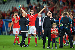 LILLE, FRANCE - Friday, July 1, 2016: Wales' Gareth Bale celebrates after a 3-1 victory over Belgium and reaching the Semi-Final during the UEFA Euro 2016 Championship Quarter-Final match at the Stade Pierre Mauroy. Ian Mitchell. (Pic by David Rawcliffe/Propaganda)