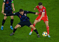 CARDIFF, WALES - Sunday, October 13, 2019: Wales' Ben Davies (R) and Croatia's Mateo Kovačić during the UEFA Euro 2020 Qualifying Group E match between Wales and Croatia at the Cardiff City Stadium. (Pic by Paul Greenwood/Propaganda)