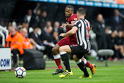 NEWCASTLE-UPON-TYNE, ENGLAND - Sunday, October 1, 2017: Liverpool's Daniel Sturridge and Newcastle United's Ciaran Clark during the FA Premier League match between Newcastle United and Liverpool at St. James' Park. (Pic by Paul Greenwood/Propaganda)