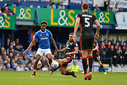 Portsmouth Forward, Jamal Lowe (18) is tackled by Milton Keynes Dons Defender, Scott Golbourne (12) during the EFL Sky Bet League 1 match between Portsmouth and Milton Keynes Dons at Fratton Park, Portsmouth, England on 14 October 2017. Photo by Adam Rivers.